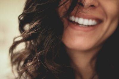 woman-with-healthy-teeth-from-flossing-smiling